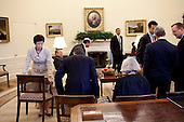 Washington, DC - June 8, 2009 -- United States President Barack Obama and Senior Staff get situated before a morning meeting in the Oval Office of the White House, June 8, 2009..Mandatory Credit: Pete Souza - White House via CNP