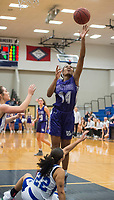 NWA Democrat-Gazette/BEN GOFF @NWABENGOFF<br /> Coriah Beck of Fayetteville makes a basket as Amber Covington of Rogers guards Friday, Feb. 9, 2018, in King Arena at Rogers High.