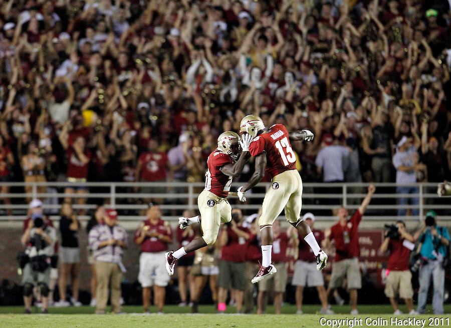 TALLAHASSEE, FL 9/17/11-FSU-OU091711 CH-Florida State's Lamarcus Joyner, left, celebrates with Nigel Bradham after Joyner intercepted an Oklahoma pass during second half action Saturday at Doak Campbell Stadium in Tallahassee. The Seminoles lost to the Sooners 23-13..COLIN HACKLEY PHOTO