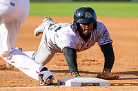 Kane County Cougars outfielder Anfernee Grier (10) dives back to first base during game one of a Midwest League doubleheader against the Wisconsin Timber Rattlers on June 23, 2017 at Fox Cities Stadium in Appleton, Wisconsin.  Kane County defeated Wisconsin 4-3. (Brad Krause/Four Seam Images)