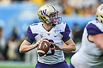 Washington Huskies quarterback Jake Browning (3) in action during the Zaxby's Heart of Dallas Bowl game between the Washington Huskies and the Southern Miss Golden Eagles at the Cotton Bowl Stadium in Dallas, Texas. Washington defeats Southern Miss 44 to 31.