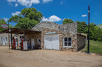 All that remains of the Ghost Town of Specer Missouri on Route 66, is a row of rock buildings that have been restored.  At one time there was a grocery store, gas station, dry goods store, and a barbershop.