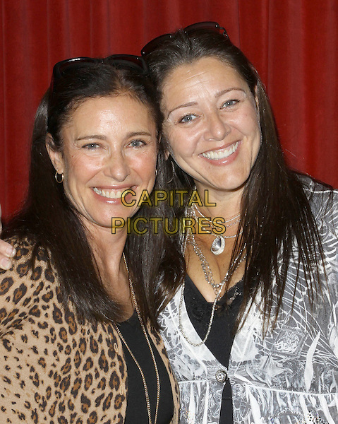 "MIMI ROGERS & CAMRYN MANHEIM.Children's Institute Hosts ""Poker For A Cause"" Celebrity Poker Tournament held At Commerce Casino Hotel, City Of Commerce, California, USA..October 17th, 2009.half length black silver top necklace leopard print jacket .CAP/ADM/KB.©Kevan Brooks/AdMedia/Capital Pictures."