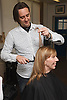 Hairdresser who has Ehlers-Danlos Syndrome (EDS), helped into employment by the Ready 4 Work team, Nottinghamshire County Council, styling a woman's hair