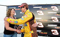 Feb. 27, 2009; Las Vegas, NV, USA; NASCAR Sprint Cup Series driver Kyle Busch congratulates fans Heather Landry and Damon Landry after they got married in victory lane following qualifying for the Shelby 427 at Las Vegas Motor Speedway. Mandatory Credit: Mark J. Rebilas-