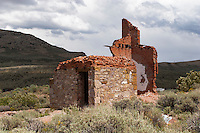 The remains of the Whitington Hotel in Hamilton, Nevada. In 1868 Hamilton started as a boomtown with 25,000 people migrating to the area where silver ore was for the taking. The town was the first county seat of White Pine County, from 1869 to 1887, when a fire led to its replacement by the town of Ely. In 1887 big-scale production ceased and the population left just as quickly as they had come. Today the town is abandoned with only the facades from a few of the buildings remaining. Photographed 07/07
