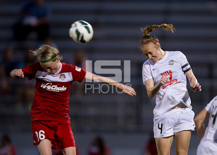 Becky Sauerbrunn (4) of FC Kansas City heads the ball away from Conny Pohlers (16) of the Washington Spirit at the Maryland SoccerPlex in Boyds, MD. The Washington Spirit tied FC Kansas City, 1-1.