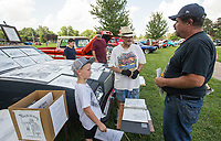 NWA Democrat-Gazette/BEN GOFF @NWABENGOFF<br /> Jon Nelson (right) and son Levi Sullins, 9, of Gentry buy artwork by Dannie Turner of Strange Kat Art from Springdale during the car show Thursday, July 4, 2019, during the 125th annual Gentry Freedom Fest at Gentry City Park.