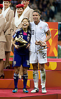 Abby Wambach (20) of the United States and Homare Sawa (10) of Japan stand with their individual trophies after the final of the FIFA Women's World Cup at FIFA Women's World Cup Stadium in Frankfurt Germany.  Japan won the FIFA Women's World Cup on penalty kicks after tying the United States, 2-2, in extra time.
