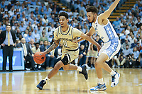 CHAPEL HILL, NC - JANUARY 4: Michael Devoe #0 of Georgia Tech drives past Shea Rush #11 of the University of North Carolina during a game between Georgia Tech and North Carolina at Dean E. Smith Center on January 4, 2020 in Chapel Hill, North Carolina.