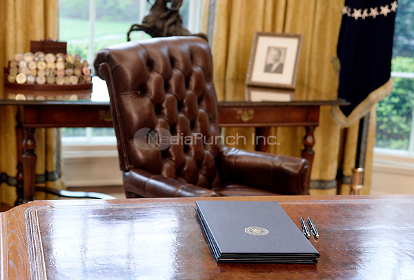 Executive Orders regarding trade lay on the Resolute desk in the Oval Office of the White House March 31, 2017 in Washington, DC. <br /> Credit: Olivier Douliery / Pool via CNP /MediaPunch