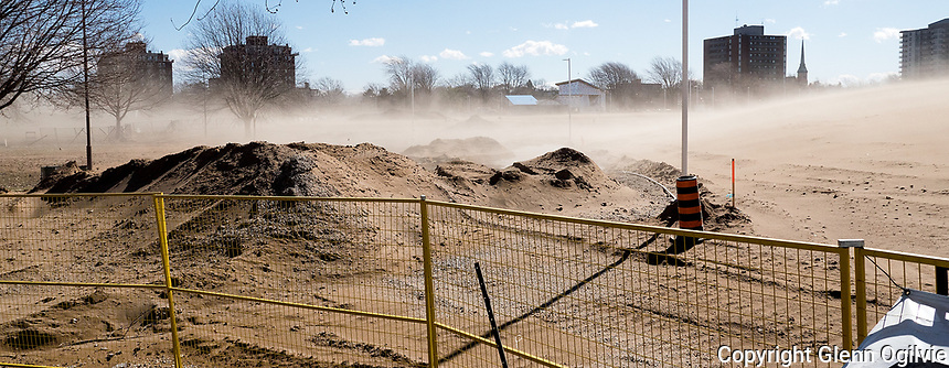 High winds created a thick cloud of blowing sand and dirt which swept across Centennial Park to Christina Street