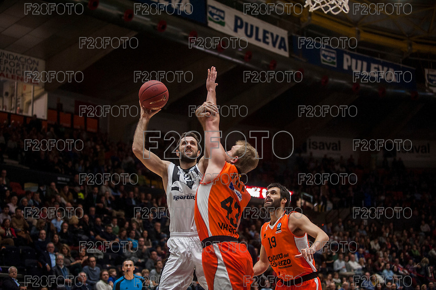 VALENCIA, SPAIN - JANUARY 6: Luke Sikma and Nikola Markovic during EUROCUP match between Valencia Basket and PAOK Thessaloniki at Fonteta Stadium on January 6, 2015 in Valencia, Spain