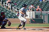 Surprise Saguaros left fielder Bryan Reynolds (10), of the Pittsburgh Pirates organization, follows through on his swing in front of catcher Tres Barrera (12) during an Arizona Fall League game against the Salt River Rafters at Salt River Fields at Talking Stick on November 5, 2018 in Scottsdale, Arizona. Salt River defeated Surprise 4-3 . (Zachary Lucy/Four Seam Images)