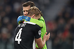 Wojciech Szczesny of Juventus embraces team mate Matthijs De Ligt after making a goal saving tackle during the UEFA Champions League match at Juventus Stadium, Turin. Picture date: 26th November 2019. Picture credit should read: Jonathan Moscrop/Sportimage