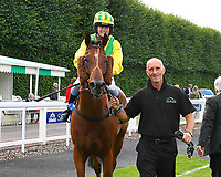 Silvington with Lad in the Winner's enclosure after winning  The Gift Of Sight Handicap  during Evening Racing at Salisbury Racecourse on 3rd September 2019