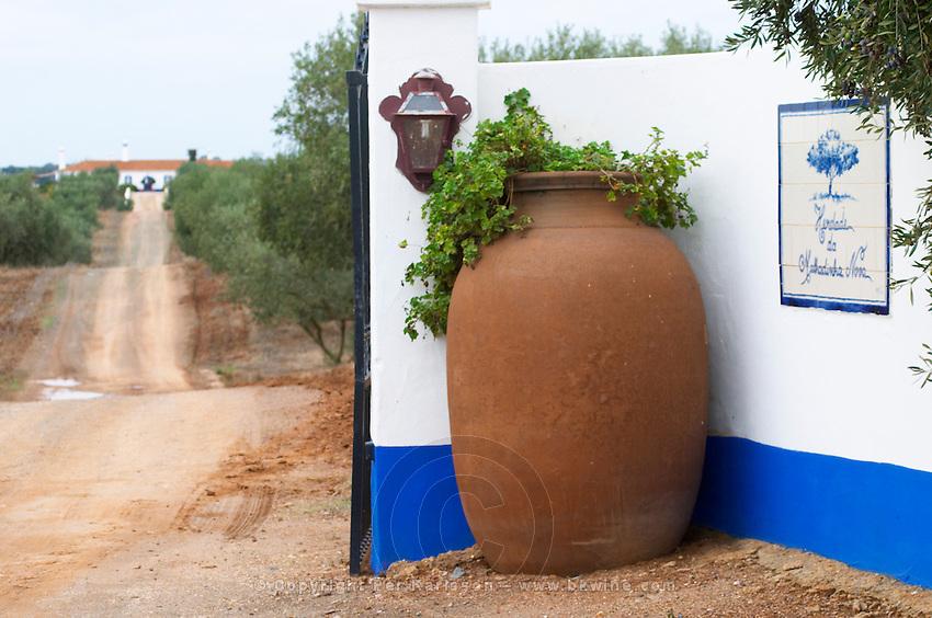 Big earthenware amphora at the vineyard entrance. Herdade da Malhadinha Nova, Alentejo, Portugal