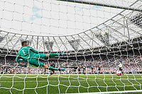 Sergio Aguero of Manchester City scores a re-taken penalty during the Premier League match between West Ham United and Manchester City at the London Stadium, London, England on 10 August 2019. Photo by David Horn.