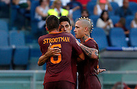 Calcio, Serie A: Roma vs Udinese. Roma, stadio Olimpico, 20 agosto 2016.<br /> Roma&rsquo;s Diego Perotti, center, celebrates with teammates Kevin Strootman, left, and Radja Nainggolan, after scoring his second goal on a penalty kick during the Italian Serie A football match between Roma and Udinese at Rome's Olympic Stadium, 20 August 2016. Roma won 4-0.<br /> UPDATE IMAGES PRESS/Riccardo De Luca