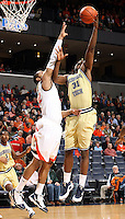 Georgia Tech's Gani Lawal(31) is defended by Virginia's Mike Scott during an ACC college basketball game Wednesday Jan. 13, 2010 in Charlottesville, Va.  (Photo/Andrew Shurtleff)