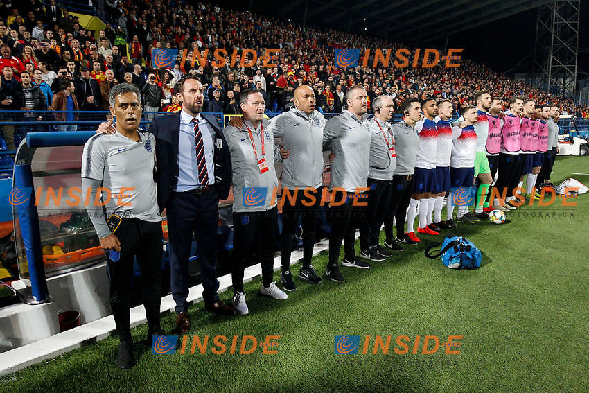England Manager Gareth Southgate sings the national anthem with his staff and bench before the UEFA Euro 2020 Qualifying Group A match  <br /> Podgorica 25-3-2019 <br /> Football Euro2020 Qualification Montenegro - England <br /> Foto Daniel Chesterton / PHC / Insidefoto <br /> ITALY ONLY