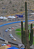 Nov. 9, 2008; Avondale, AZ, USA; NASCAR Sprint Cup Series driver Jamie McMurray (26) leads the field during the Checker Auto Parts 500 at Phoenix International Raceway. Mandatory Credit: Mark J. Rebilas-