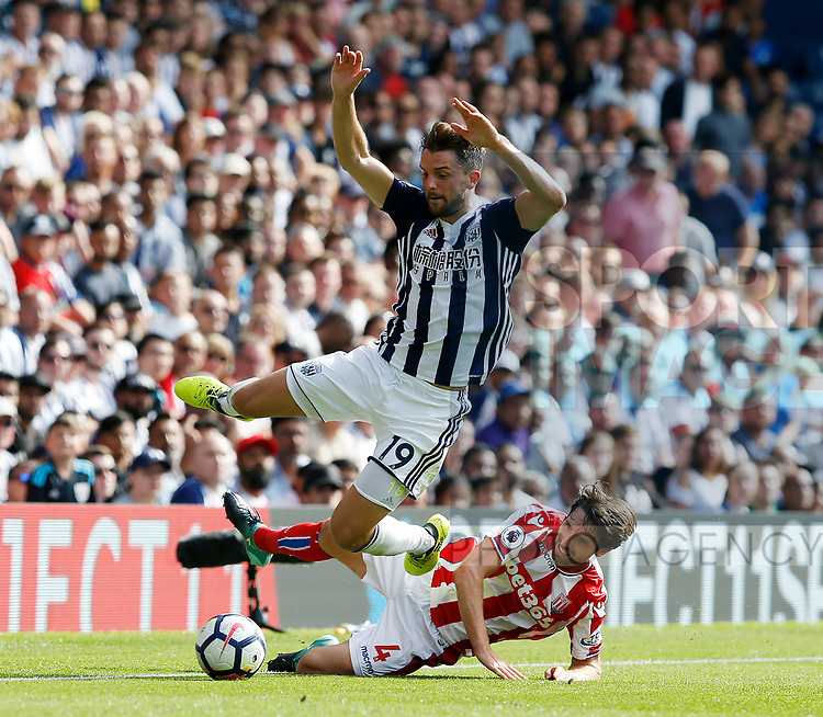 Jay Rodriguez of West Bromwich Albion tackled by Joe Allen of Stoke City during the premier league match at the Hawthorn's Stadium, West Bromwich. Picture date 27th August 2017. Picture credit should read: Simon Bellis/Sportimage