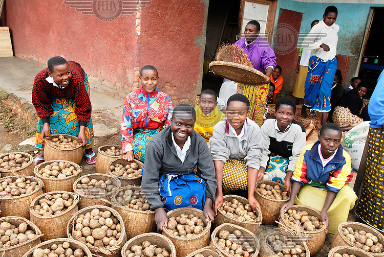 Girls with baskets filled with potatoes. Food is being prepared for students at the Rambura Filles Secondary School, where secretarial and administration skills are taught.