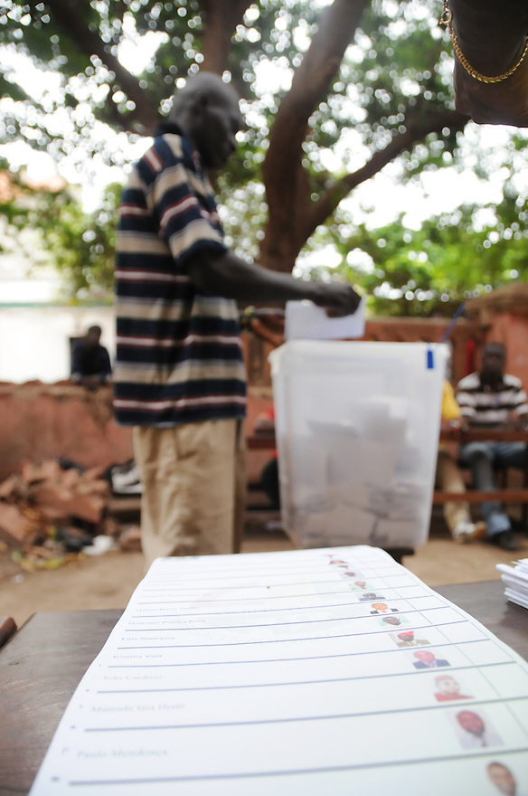 Bissau/June 28 - A voter in Guinea-Bissau casts his ballot in the country's presidential election on June 28. The West African nation is one of the poorest on the continent--it is ranked 171 out of 179 nations in the U.N. Development Programme's Human Development Index, and life expectancy at birth is less than 46 years. The election comes four months after the leader João Bernardo Vieira was killed by mutinous troops..