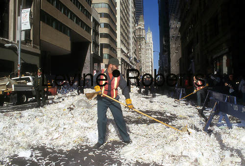 Sanitation workers clean up ticker tape on Broadway in Lower Manhattan in New York on October 29, 2996 after the ticker tape parade thrown for the New York Yankees after their win in the World Series of Baseball. (© Frances M. Roberts)