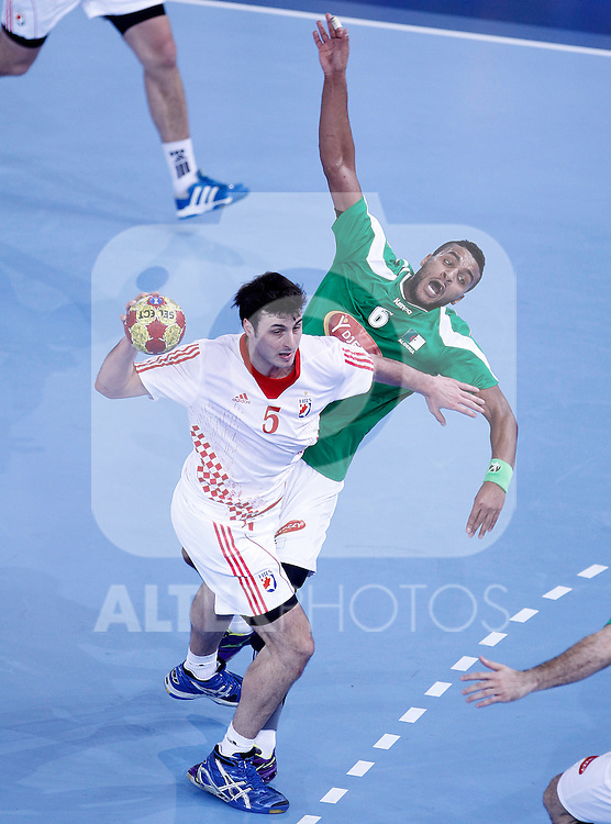 Algeria's Messaoud Berkous (r) and Croatia's Domagoj Duvnjak during 23rd Men's Handball World Championship preliminary round match.January 14,2013. (ALTERPHOTOS/Acero)