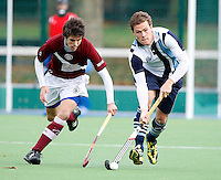 Jono Holt (R) of Hampstead outpaces Chris Gregg during the England Hockey League Mens Premier Division game between Hampstead & Westminster HC and Loughborough Students at The Paddington Recreation Ground, London on Sun Nov 8, 2009