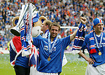 Neil McCann with thew SPL trophy after Rangers win the SPL on goal difference from Celtic
