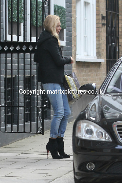 EXCLUSIVE ALL ROUND PICTURE: MATRIXPICTURES.CO.UK.PLEASE CREDIT ALL USES..WORLD RIGHTS..Make-up free English fashion model Kate Moss is pictured wearing jeans and a black hooded jacket as she visits a friend in central London...APRIL 11th 2013..REF: WTX 132398