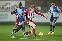 Harvey Rodgers of Accrington Stanley tries to get away from Adebayo Akinfenwa of Wycombe Wanderers <br /> during the Sky Bet League 2 match between Accrington Stanley and Wycombe Wanderers at the wham stadium, Accrington, England on 28 February 2017. Photo by Tony  KIPAX.