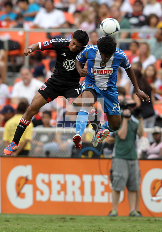 WASHINGTON, D.C. - AUGUST 19, 2012:  Andy Najar (14) of DC United heads over Sheanon Williams (25) of the Philadelphia Union during an MLS match at RFK Stadium, in Washington DC, on August 19. The game ended in a 1-1 tie.