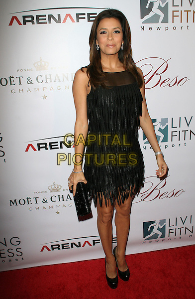"EVA LONGORIA PARKER.""Beso"" New Years Eve Hosted By Eva Langoria held at Beso Restaurant, Hollywood, California, USA..December 31st, 2008.full length black dress clutch bag tassels fringed tiered shoes.CAP/ADM/KB.©Kevan Brooks/AdMedia/Capital Pictures."