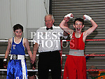 Jamie Grey, St. Monicas Boxing Club (Red) and Caolan Finnegan, Silverbridge Boxing Club (Blue) at the Boxing Championships at St. Cianan's Boxing Club, Duleek.<br /> <br /> Photo: Jenny Matthews