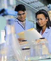Lab technicians reviewing test results