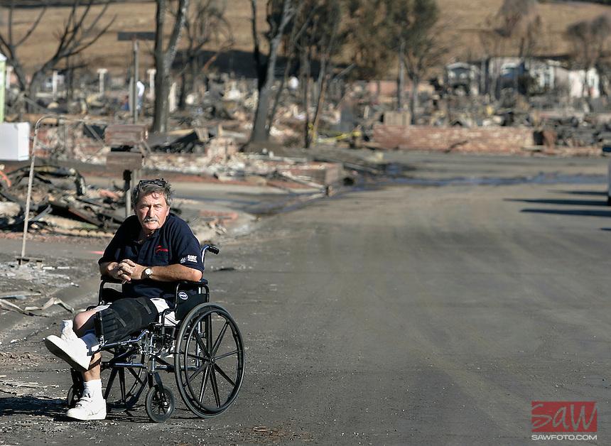 LOS ANGELES,CA - NOVEMBER 19,2008: Oakridge mobile home resident Michael Brennan,63, surveys the damage in front of his home, November 19, 2008.