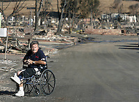 LOS ANGELES,CA - NOVEMBER 19,2008: Oakridge mobile home resident Michael Brennan,63, surveys the damage in front of his home, November 19, 2008.