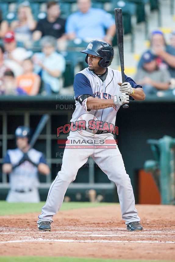 Colorado Springs Sky Sox third baseman Rafael Ynoa (6) batting during the Pacific League game against the Oklahoma City RedHawks at the Chickasaw Bricktown Ballpark on August 3, 2014 in Oklahoma City, Oklahoma.  The RedHawks defeated the Sky Sox 8-1.  (William Purnell/Four Seam Images)