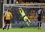 Goalkeeper Scott Fox tips the ball away to save Ross County