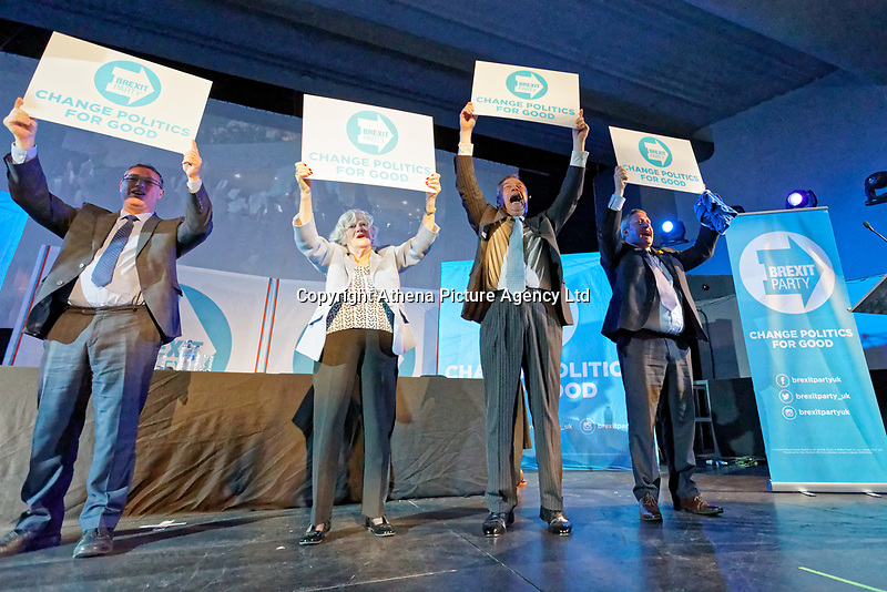 Pictured: Anne Widdecombe, Nigel Farage and other party candidates raise placards at the end of the rally. Tuesday 30 April 2019<br /> Re: Nigel Farage and Anne Widdecombe at the Brexit Party rally at The Neon in Clarence Place in Newport, south Wales, UK.
