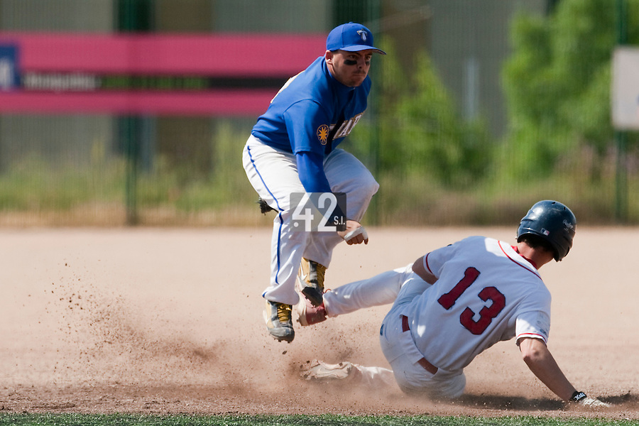 24 May 2009: Damien Teygeman of Senart jumps over Anthony Piquet of La Guerche as he throws the ball to first base during the 2009 challenge de France, a tournament with the best French baseball teams - all eight elite league clubs - to determine a spot in the European Cup next year, at Montpellier, France. Senart wins 8-5 over La Guerche.