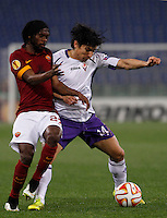 Calcio, Europa League: Ritorno degli ottavi di finale Roma vs Fiorentina. Roma, stadio Olimpico, 19 marzo 2015.<br /> Fiorentina's Matias Fernandez, right, is challenged by Roma's Gervinho during the Europa League round of 16 second leg football match between Roma and Fiorentina at Rome's Olympic stadium, 19 March 2015.<br /> UPDATE IMAGES PRESS/Isabella Bonotto