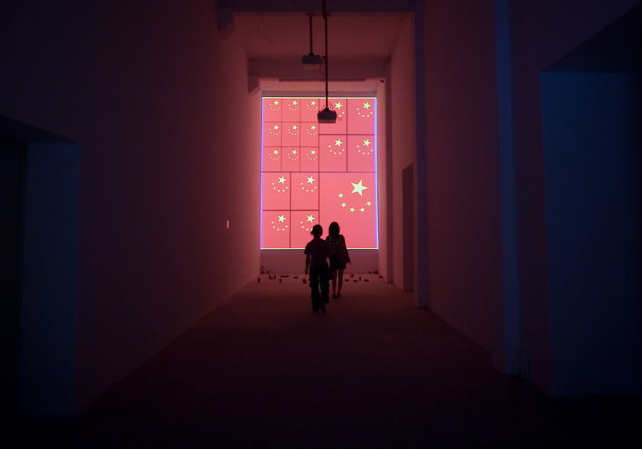 A visitor looks at a modern art installation in a gallery in Dashanzi a trendy artisit's district in northern Beijing.