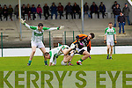 Barry Shanahan of Ballydonoghue watches his team player Diaramid Behan tackled by Michael O'Connor of Sneem/Derrynane in the Credit Union County League Division 5 last Sunday in Ballydonoghue.