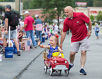 NWA Democrat-Gazette/BEN GOFF @NWABENGOFF<br /> Emmery Antoine, 6, of Bella vista rides around with Steve Morrow, manager of Allen's Food Market, Thursday, July 4, 2019, before the Bella Vista Patriots Parade at Sugar Creek Shopping Center. Emmery is a recipient of a wish for a playhouse from Make-A-Wish Mid-South.