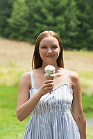 Young woman holding ice cream cone